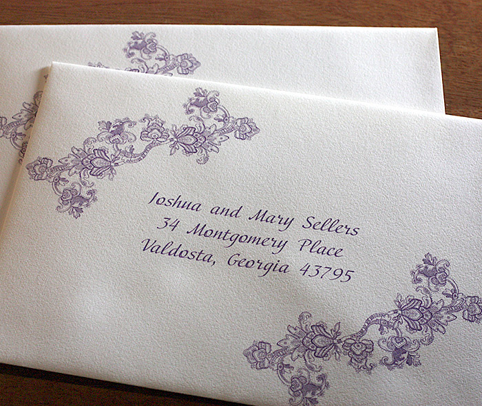 elegant purple vintage lace pattern on custom addressed wedding invitation envelope