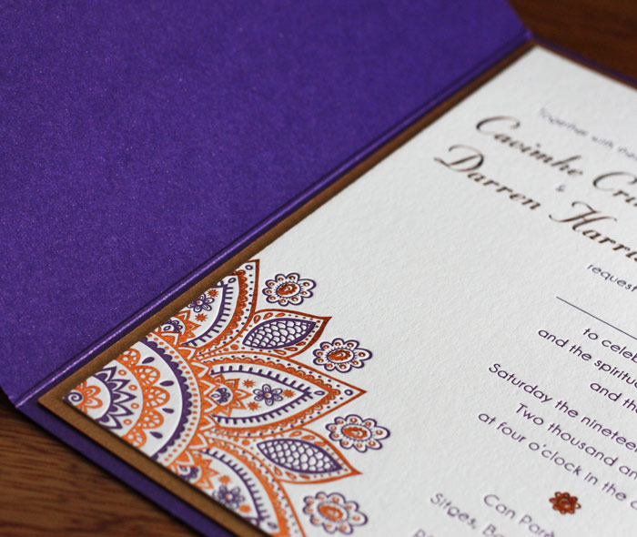 elegant indian mandala wedding invitation in copper foil and letterpress mounted in purple pocket folder