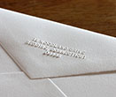 return address, hand embosser, wedding invitations