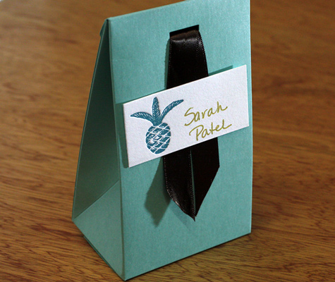 aqua favor box with brown ribbon